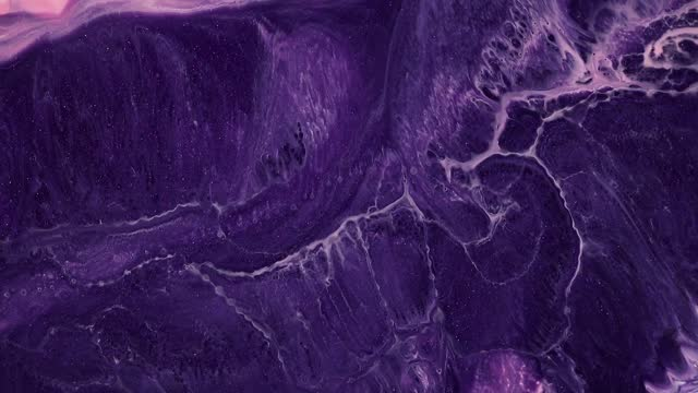 Fluid art painting video, modern acrylic texture with colorful waves. Liquid paint mixing backdrop with splash and swirl. Detailed background motion with purple, lilac and pink overflowing colors.