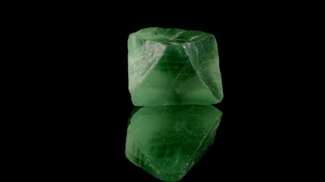 Fluorit - rotating mineral Fluorit crystal rotating on reflecting surface. chlorine stock videos & royalty-free footage
