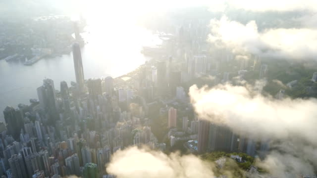 fly above hong kong city 4k video - центральный район стоковые видео и кадры b-roll