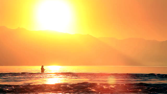 Fly fishing and wading and casting at sunset. Patagonia Argentina video