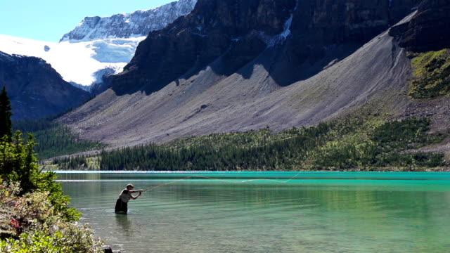 fly fishing in a glacier fed lake - meta bildbanksvideor och videomaterial från bakom kulisserna