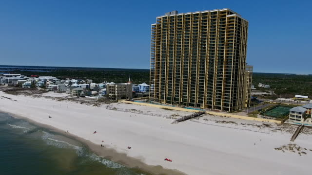 fly into beach building - gulf coast states stock videos & royalty-free footage