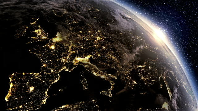 Fly over city lights from Space till morning