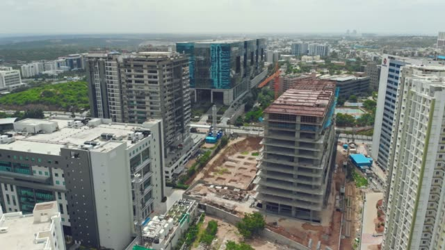 fly over construction buildings & apartments - concrete architecture stock videos & royalty-free footage
