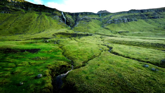 Fly over green valley in Iceland video