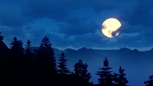 Fly over mountain ridge with full moon