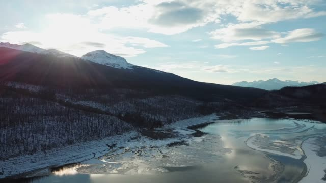 Fly over mountains in Winter