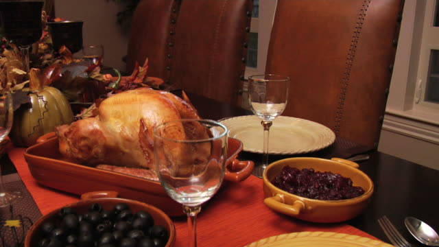 Fly Over Thanksgiving Dinner Fly over shot of Thanksgiving Dinner on table. More from this series. chair stock videos & royalty-free footage