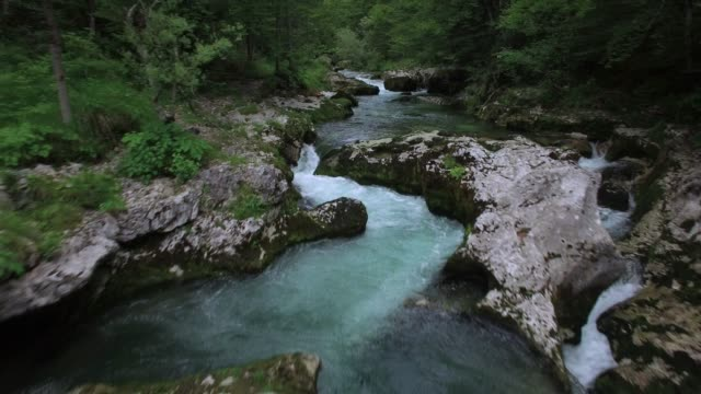 Fly Over The Surface Of A Mountain River , Slovenia Fly Over The Surface Of A Mountain River , Slovenia rapids river stock videos & royalty-free footage