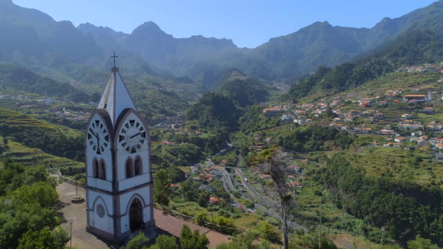 fly past an old church tower on a hill in madeira - portogallo video stock e b–roll