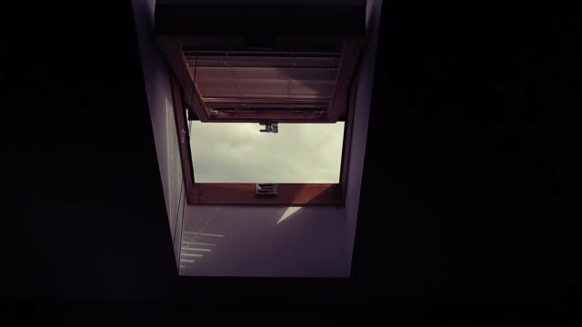 fly throught open roof window, skylight - stabilized shot стоковые видео и кадры b-roll