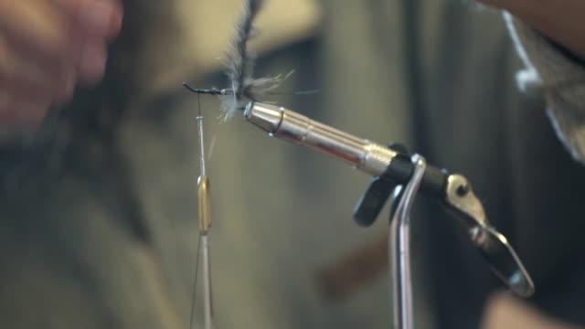 vídeos y material grabado en eventos de stock de mosca anudar - amarrado