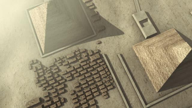 flying above a 3d animation of the giza platform egypt - pyramidform bildbanksvideor och videomaterial från bakom kulisserna