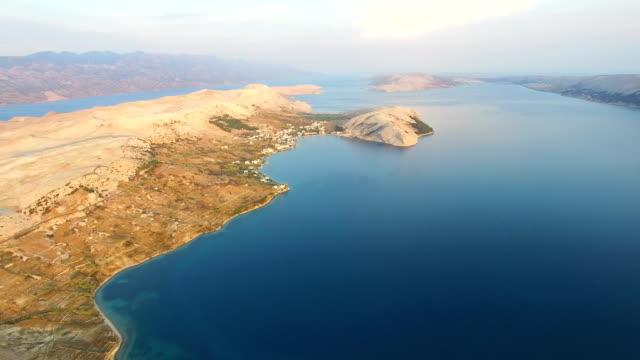 Flying above barren landscape of Pag island video