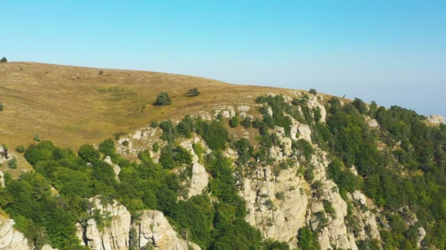 Flying Above Cliffs Formations In Mountains. Aerial View