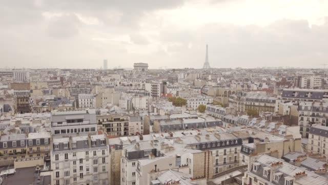 flying above roofs of paris - parigi video stock e b–roll