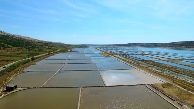 Flying above salt evaporation ponds on Pag island, Croatia video