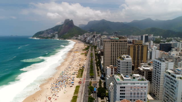 flying above sandy ipanema beach in  rio de janeiro, brazil - aerial beach stock videos & royalty-free footage