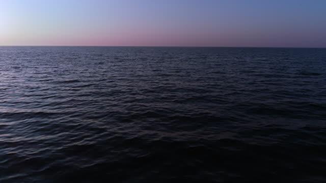 Flying Above Sea Water Surface Towards Horizon