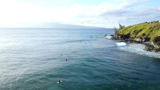 Flying Above Surfers Floating Off Maui Island's Egde video
