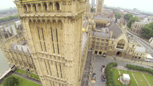 flying above the houses of parliament - vintage architecture stock videos & royalty-free footage