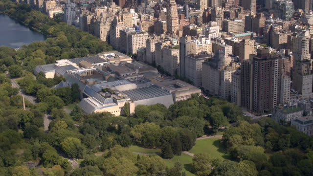AERIAL: Flying above Upper East side overlooking green Central park in New York