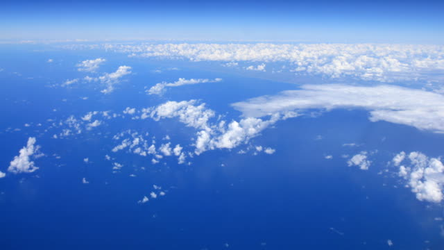 Flying above white clouds on blue sky and earth time-lapse video