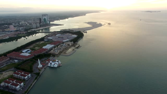 Flying aerial at Malacca Island during sunrise, West Coast Malaysia video
