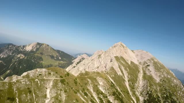 POV Flying along a mountain ridge in sunshine