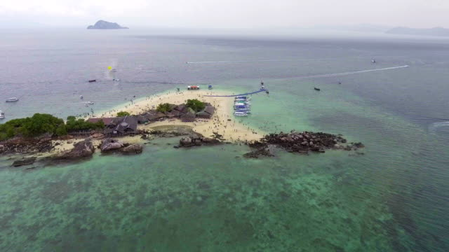 Flying around Beautiful island with clear water and blue sky, Aerial view video