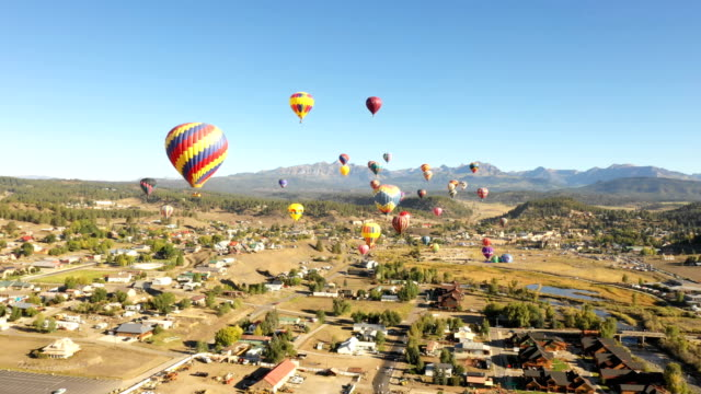 Flying Around Group of Hot Air Balloons in Colorado video