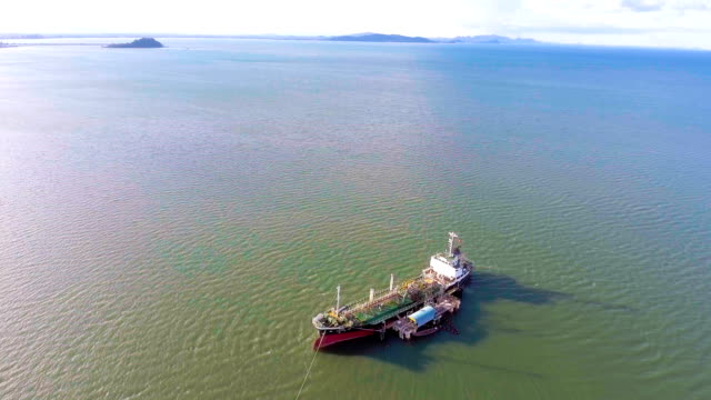 Flying Around Oil Tanker Ship Aground on Shallow Water, Aerial Video video