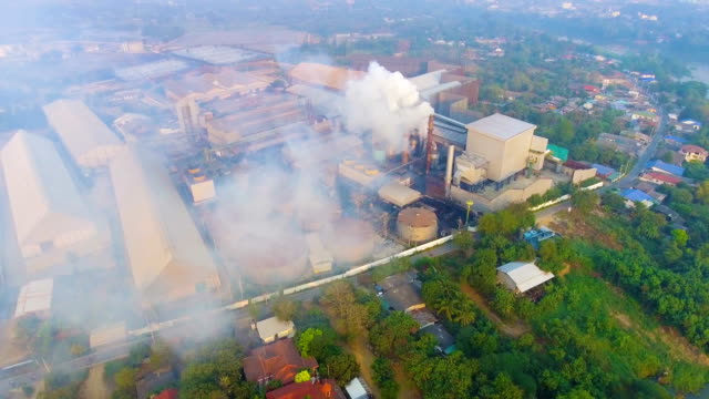 Flying around Smoke chimneys with white smoke while sugar produce with drone, Aerial video video
