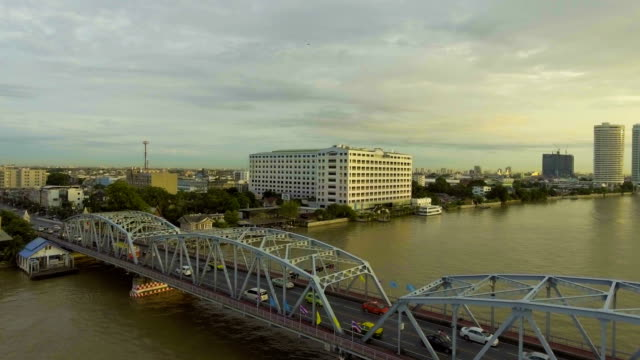 Flying around Steel Bridge cross River with Traffic in the Morning, Aerial view