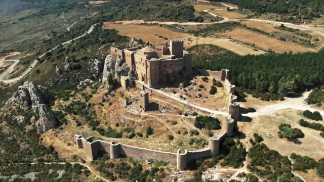 Flying around the Loarre Castle in Aragon, Spain during bright sunny day. It's one of Flying around the Loarre Castle in Aragon, Spain during bright sunny day. It's one of fort stock videos & royalty-free footage