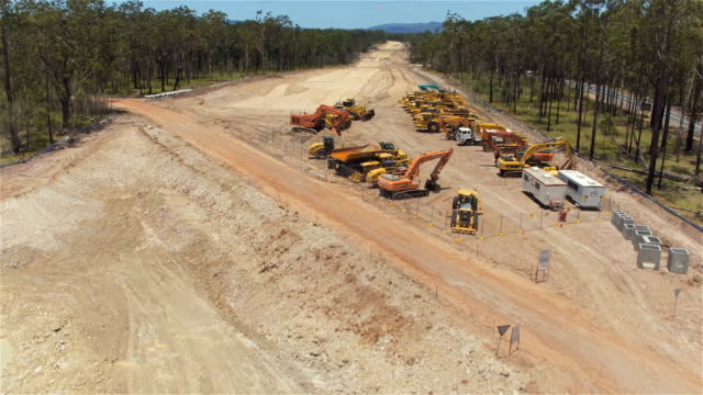 AERIAL: Flying close above gravel roadwork zone and construction machinery video