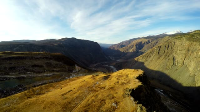 Flying Close to the Rock in Mountain Gorge at Sunset video