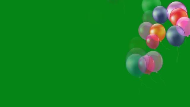 vidéos et rushes de vol de ballons colorés graphiques de mouvement vert d'écran - en botte ou en grappe