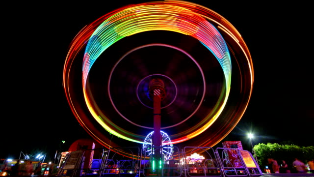 Flying colours Magnificent colours on ferris wheel in the amusement park. Loopable. go cart stock videos & royalty-free footage