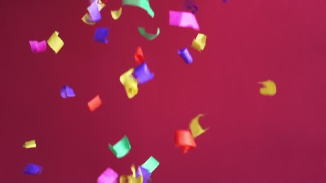 flying confetti in 120fps on red background - kompozycja flat lay filmów i materiałów b-roll