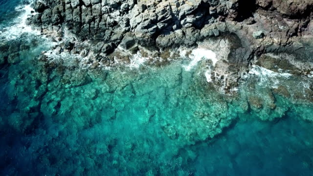Flying Directly Above Rocky Shoreline on Maui Island video