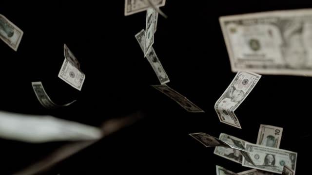 SLO MO Flying dollar bills on black background