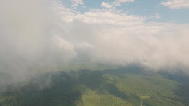 Flying drone in the clouds.