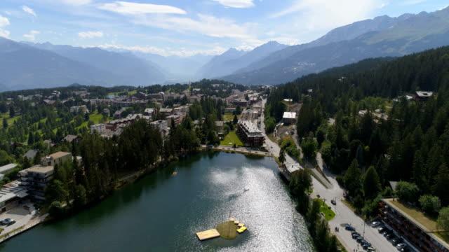 Flying high over Crans-Montana Grenon lake - Aerial 4K - Phantom 4 PRO video