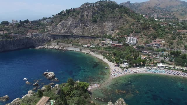 Flying in Isola Bella in Taormina, Italy