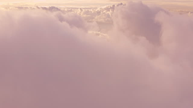 Flying in the midst of a dreamy purple cloudscape