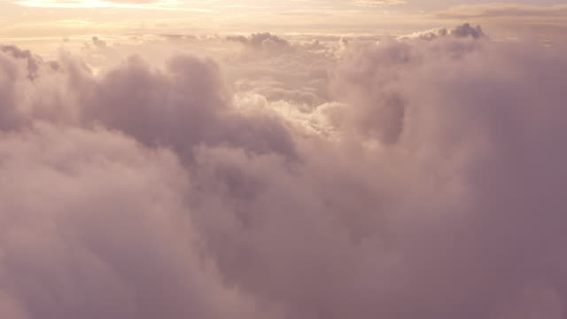 Flying in the midst of a dreamy purple cloudscape video