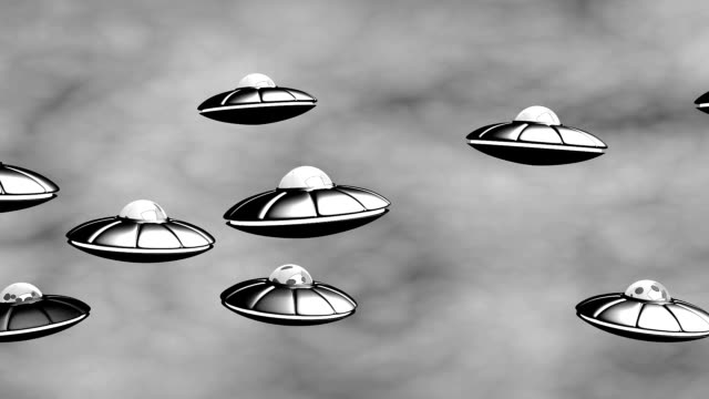UFO flying in the sky. Loop, alpha. video