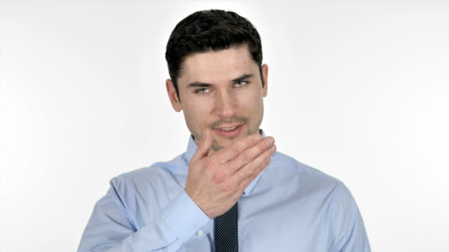 flying kiss by smiling businessman on white background - kiss стоковые видео и кадры b-roll