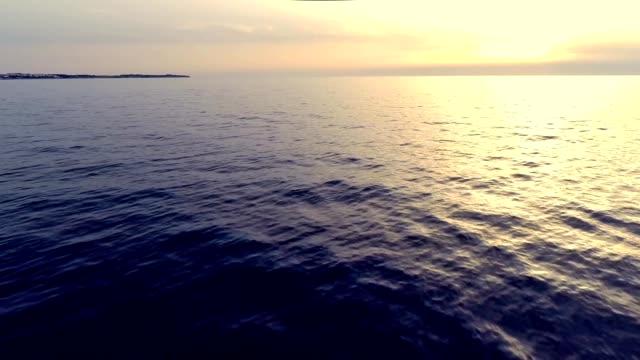 flying low over the mediterranean sea by sunset - viadukt bildbanksvideor och videomaterial från bakom kulisserna